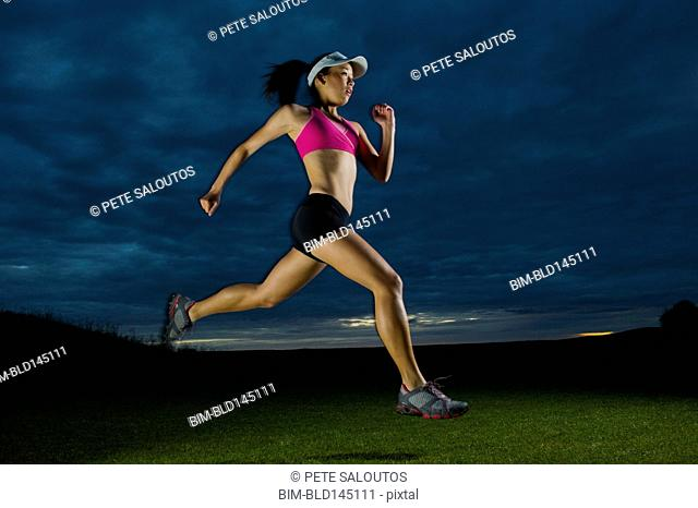 Japanese woman running at night