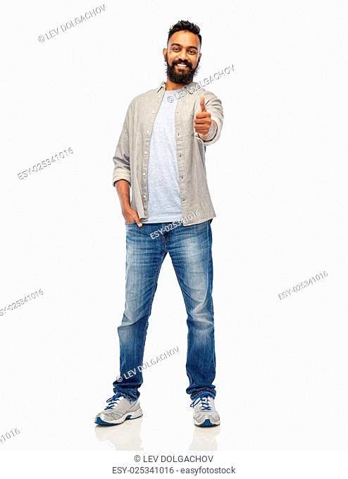 people, gesture and ethnicity concept - happy smiling indian man showing thumbs up over white