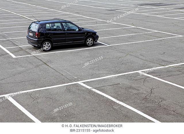A single car parked on a large parking lot, PublicGround