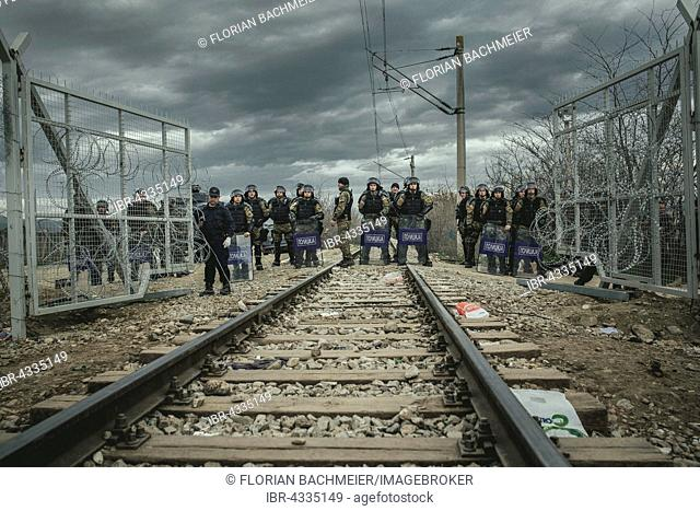 Idomeni refugee camp on the Greek Macedonia border, Macedonian security forces are securing the transit of a freight train, Idomeni, Central Macedonia, Greece