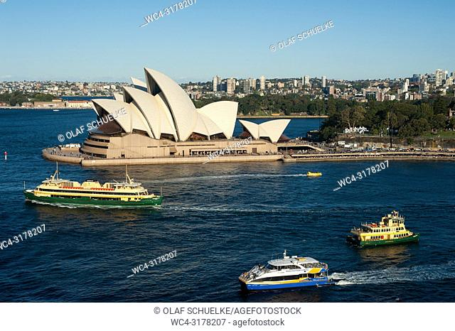 Sydney, New South Wales, Australia - An elevated view of the Sydney Opera House on Bennelong Point with ferry boats in the bay