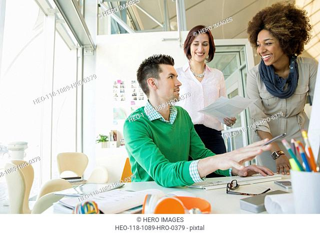 Business people meeting at desk in office