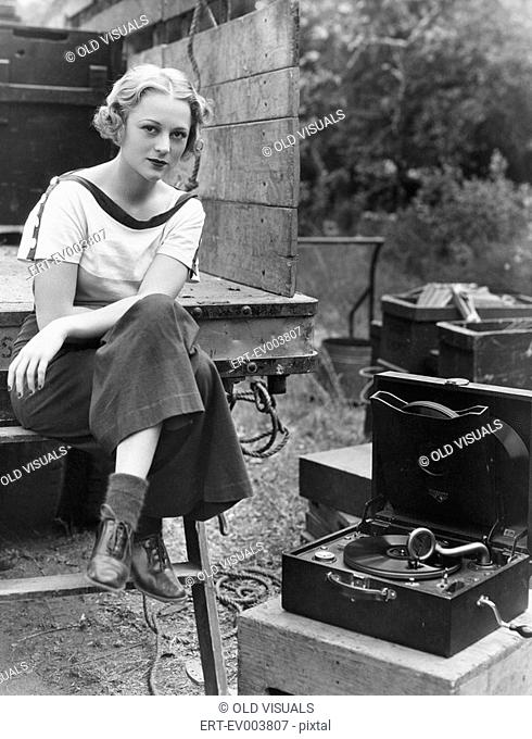 Portrait of woman with record player All persons depicted are not longer living and no estate exists Supplier warranties that there will be no model release...