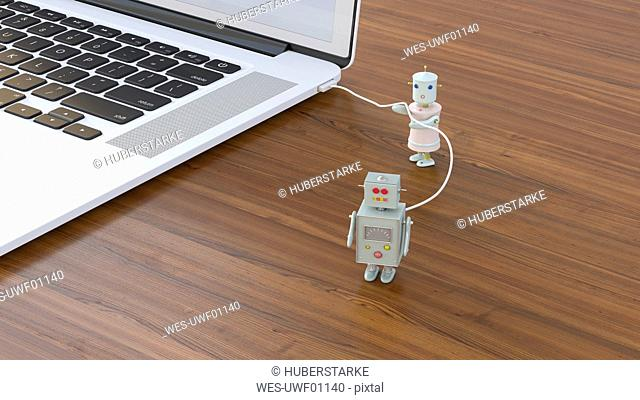 Male robot being charged at laptop, 3D rendering