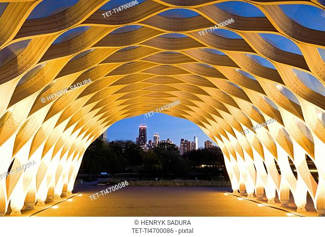 USA, Illinois, Chicago, Illuminated tunnel with city skyline in distance, dusk