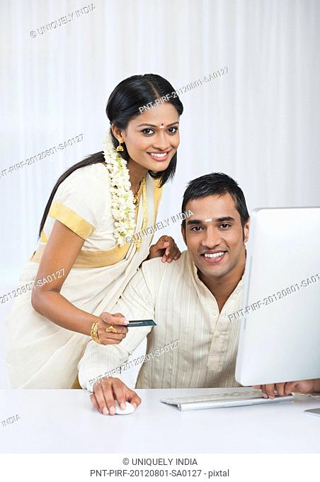 South Indian couple shopping online