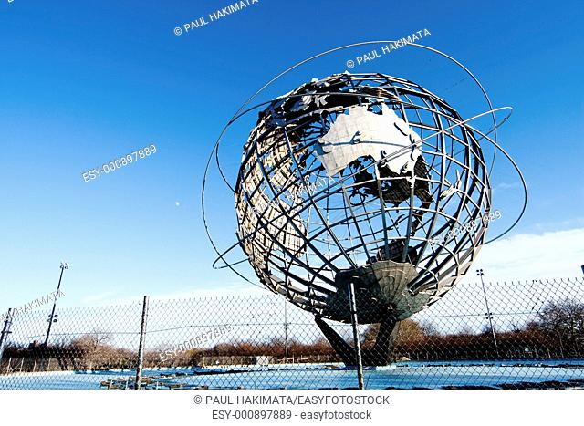 The Earth World Unisphere globe in Flushing Meadows Corona Park in Queens New York at a bright sunny day with blue skies