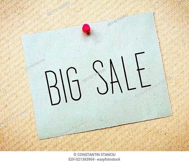 Recycled paper note pinned on cork board.Big Sale Message. Concept Image