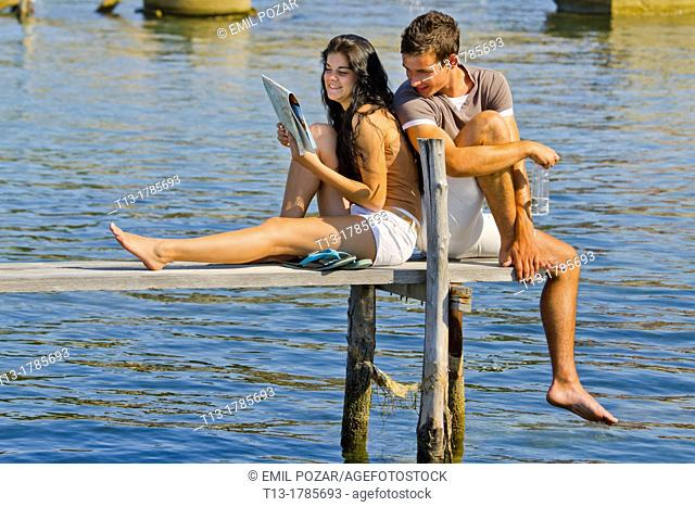 Young couple on a wooden pier