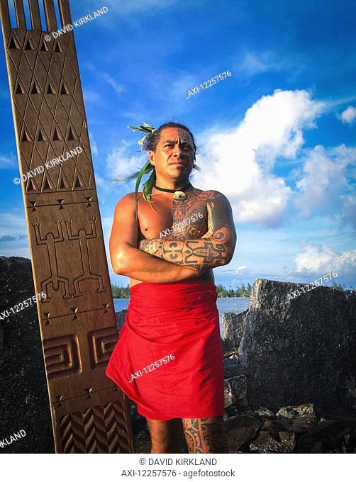 Tihoti, a tahitian Tattooist standing on sacred site; Tahiti