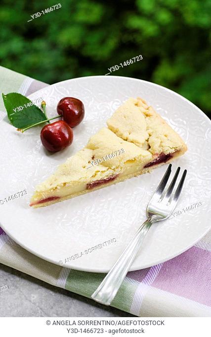 Cherry pie and cream cake slice