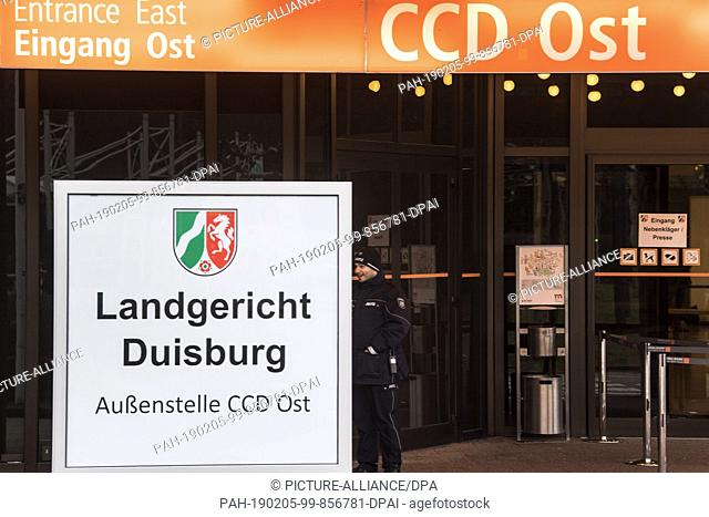 05 February 2019, North Rhine-Westphalia, Düsseldorf: A judicial officer stands in front of the CCD Ost building in Düsseldorf