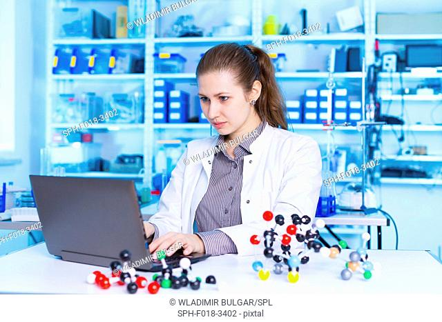Female scientist using laptop in the laboratory