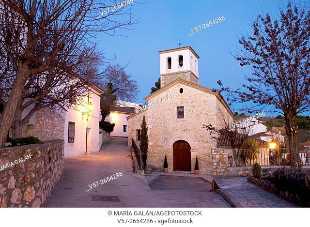 Street and church at nightfall. Olmeda de las Fuentes, Madrid province, Spain