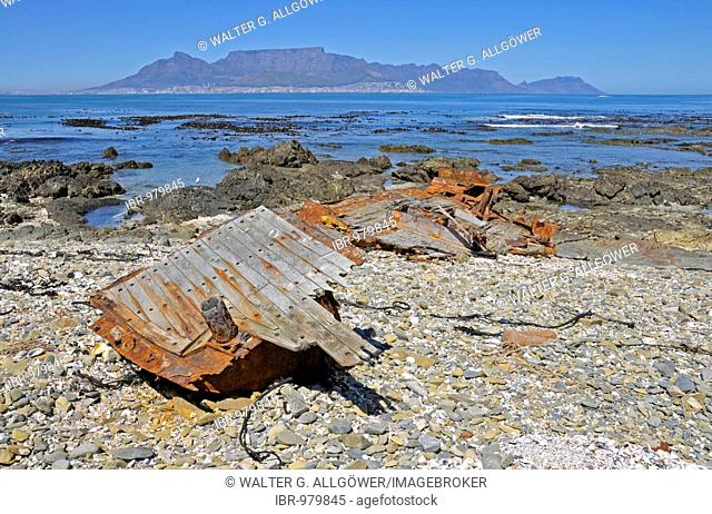 Shipwreck on Robben Island, former prison island, in the background Cape Town and Table Mountain, South Africa, Africa