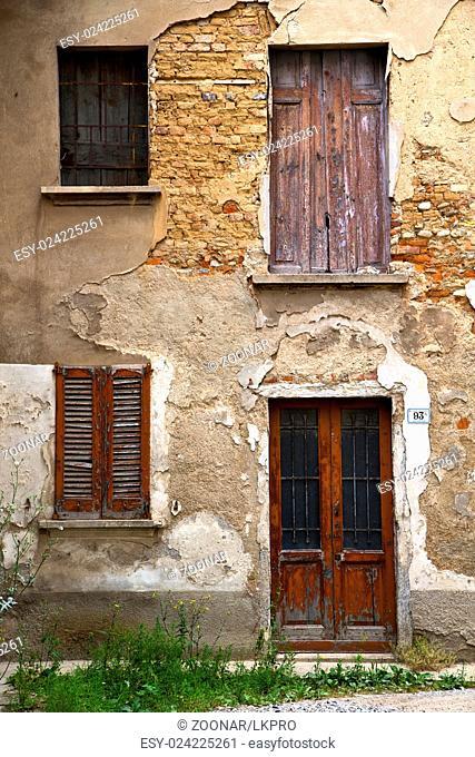 brown door europe  in the milano  window closed brick grass