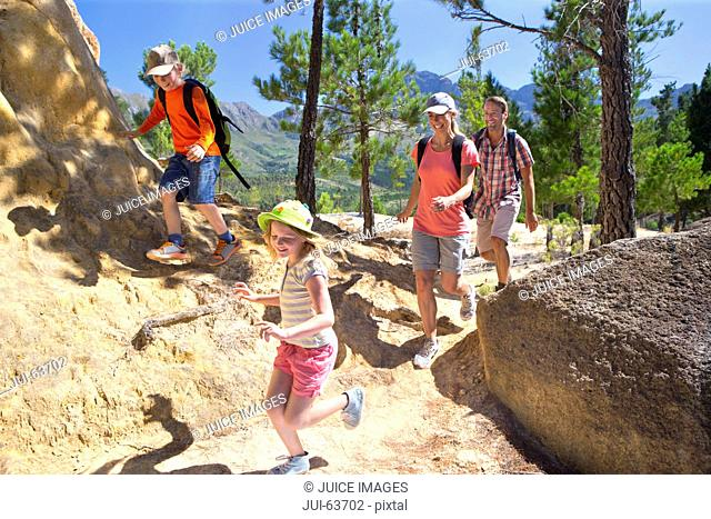Family hiking on mountain path