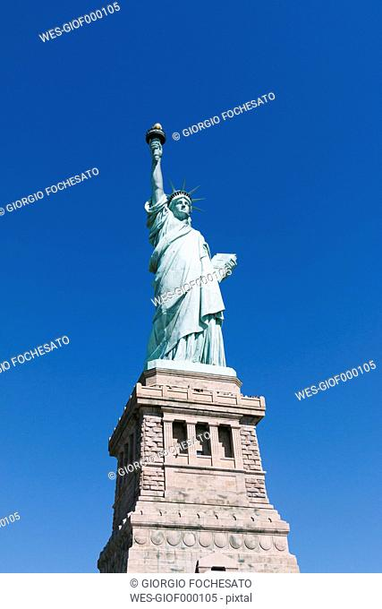USA, New York City, Statue of Liberty in front of blue sky