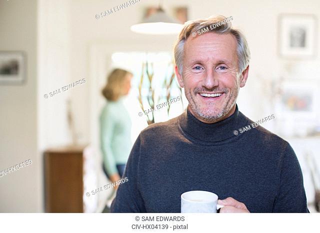 Portrait smiling, confident mature man drinking tea
