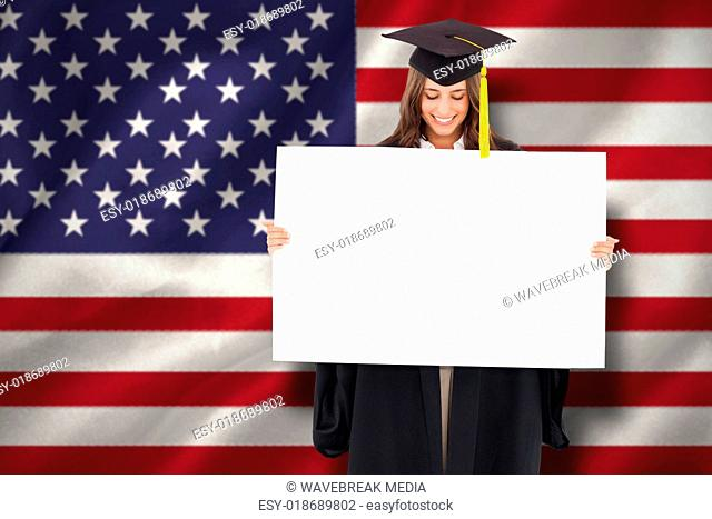 Composite image of a smiling woman as she holds and looks at a blank sheet in front of her