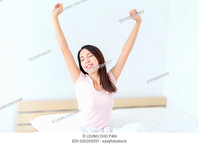 Woman wak up morning and arms stretched slightly upwards