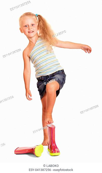 Charming little blond girl in a skirt and blouse by wearing rubber boots isolated on white background