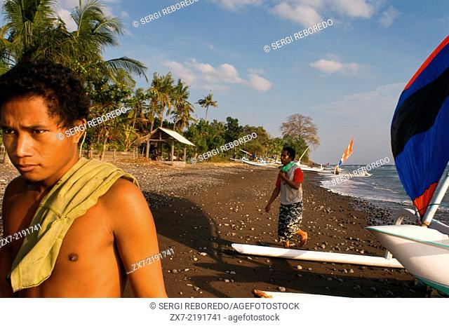Some fishermen take their boats to the shore near the beach of Amed, a fisherman village in East Bali. Amed is a long coastal strip of fishing villages in East...
