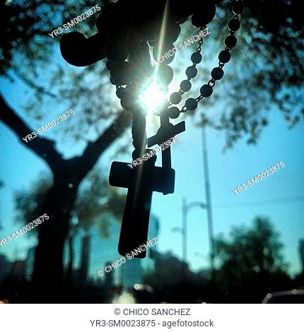A rosary decorates a taxi in Mexico City, Mexico