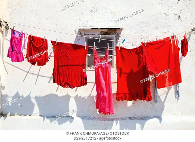 Italy, Procida - Red clothes on line drying in the sun