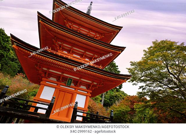 Artistic photo of Koyasu pagoda to goddess Koyasu Kannon where women come asking for safe childbirth, at Kiyomizu-dera Buddhist temple in autumn