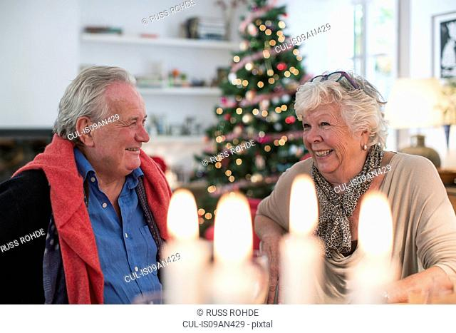 Senior couple chatting at christmas lunch table