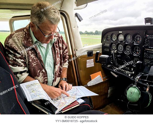 Seppe Airfield, Oudenbosch, Netherlands. Pilot of a single prop Cessna plotting his route pre flight