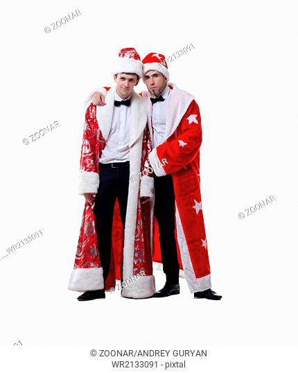 Funny friends posing in coats of Santa Claus