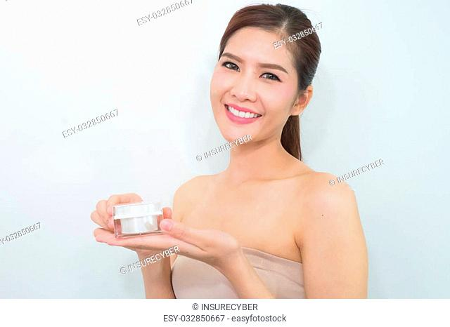 beautiful woman applying cosmetic cream,solated with clipping path