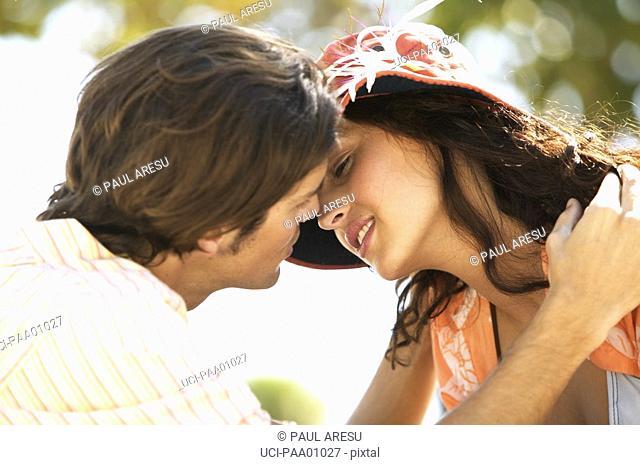 Young Hispanic couple kissing