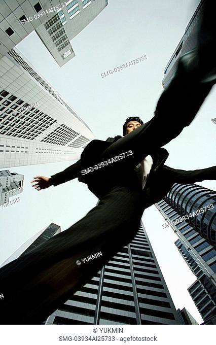 Bottom view of businessman walking