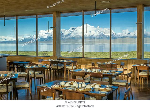 Dining room of Tierra Patagonia Hotel facing Lake Sarmiento and Torres del Paine National Park in Patagonia; Magallanes, Chile