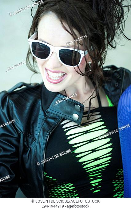 A 24 year old brunette woman in with white rimmed sunglasses
