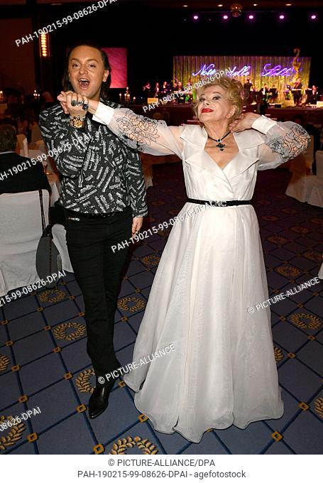 15 February 2019, Berlin: 69th Berlinale - Notte delle Stelle: Sandra Milo, Italian actress, and Julian F.M. Stöckel, fashion designer