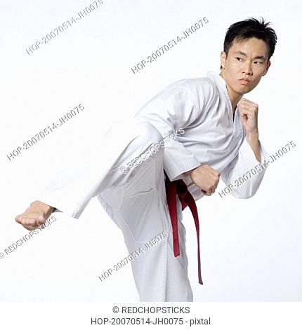 Young man practicing side kick