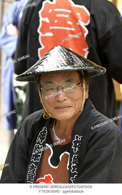 Japanese man in traditional dress at Takayama festival, Japan, Asia