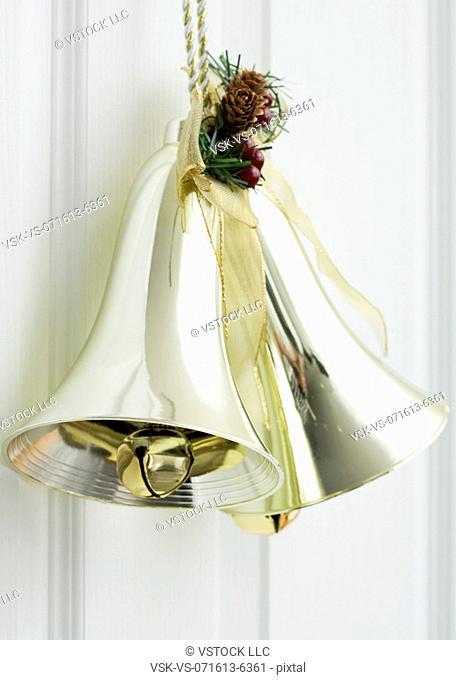 Close up of golden bell hanging on door