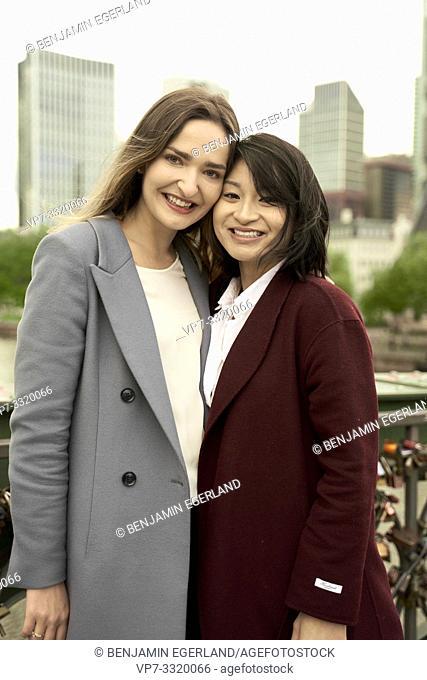 women in city, head next to head, in Frankfurt, Germany