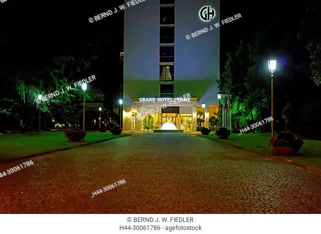 Europe, Italy, Veneto Veneto, Montegrotto Terme, Viale Stazione, hotel Grand Terme, entrance, fountain, in the evening, architecture, trees, hotel, building