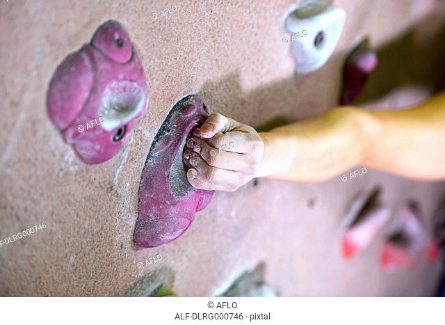 Close up of Japanese climbing athlete in action