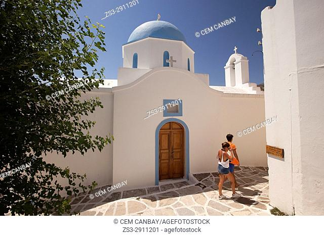 Tourists in front of the blue domed church in Lefkes town, Paros, Cyclades Islands, Greek Islands, Greece, Europe
