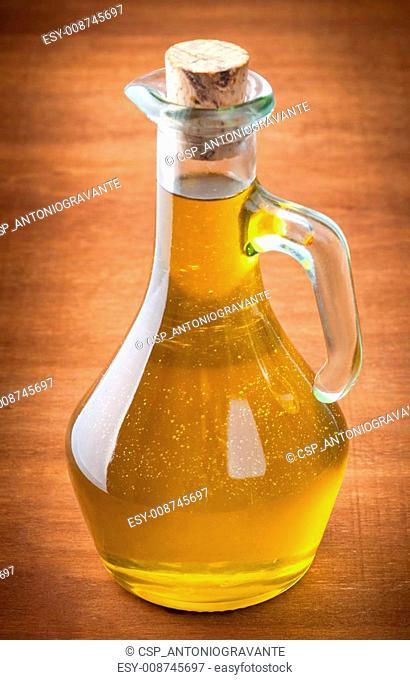 Olives and a bottle of olive oil