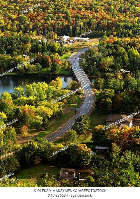 Aerial fall nature scenery of a winding road crossing the Lake of Bays  Dorset, Muskoka, Ontario, Canada