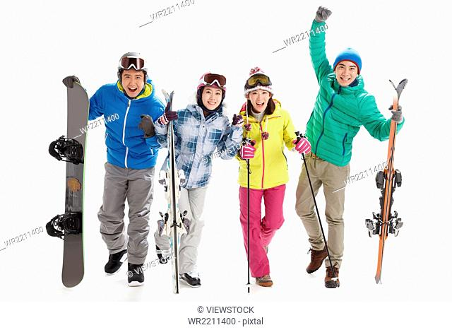 Young men and women ski