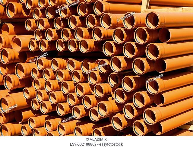 Stacked PVC orange pipes